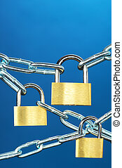 Strong security systems - Close up of padlocks and chain on...