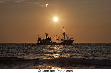Fishing vessel at the sunset - Beautiful sunset and a...