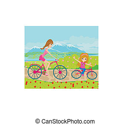 Mother and daughter biking in the park