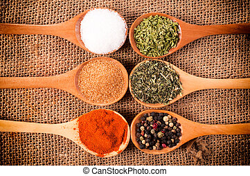Spices above - Group of spices in the wooden spoon from...