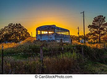 old school bus in field