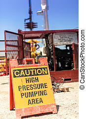 franking high pressure caution pumping sign during a Frau...