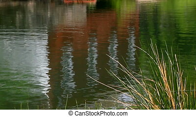 Reflection in the water of very old - Reflection of Red...