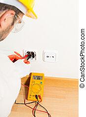 Performing a repair electrician - Electrician performing...