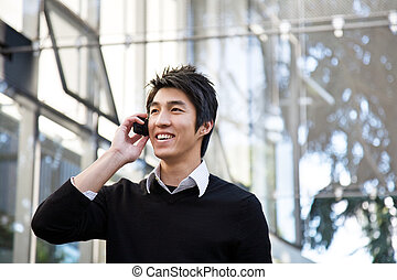 Casual asian businessman on the phone - A casual asian...