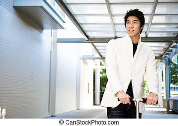 Young casual asian - A shot of a young casual asian male...
