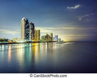 skyline of Miami sunny isles by night with reflections over...