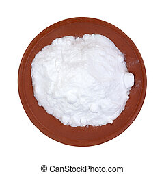 Baking soda in red clay bowl - Top view of baking soda in a...