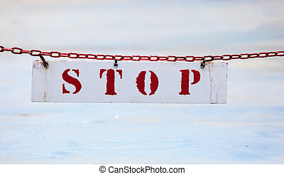 Stop sign hanging on a chain