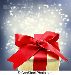 Golden gift box with big red ribbon - Golden present box...