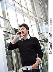 Casual asian businessman on the phone - A shot of a casual...