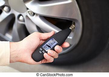 Tire pressure sensor. Auto concept.