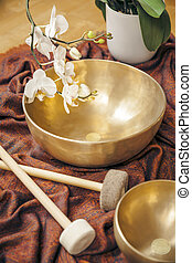 singing bowls - An image of some singing bowls and a white...