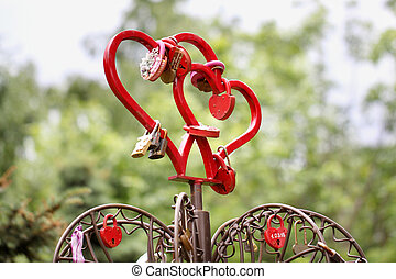 Two red hearts with iron locks