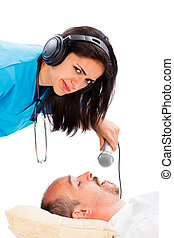Snoring Is Too Loud - Doctor lady listening to a sleeping...