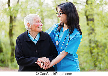 Happy Patient and Doctor - Portrait of caring nurse and...