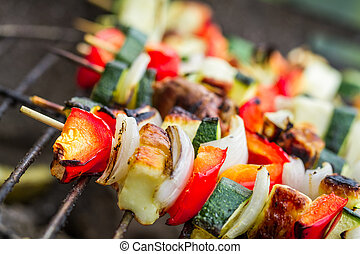 Skewers with chicken and vegetables on the grill