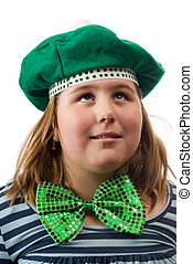 Saint Patricks Day - A young girl wearing a green hat and...