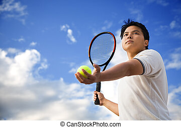 Asian male playing tennis - A young sporty asian male...