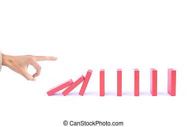 casual game domino - finger pushing dominoes causing chain...