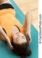 Sit ups - An Asian lady doing her sit ups exercise in a gym