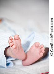 Newborn baby feet - A shot of a newborn baby feet
