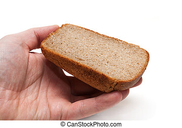 Piece of the pumpernickel in hand isolated on white...
