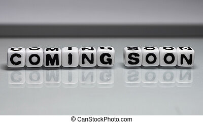 Comming soon - Coming soon message on glass sheet which is...