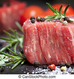 Raw Steak with Peppercorns and Herbs - Raw beef steak with...