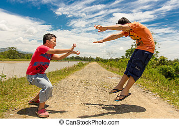 Kids playing martial arts outdoor