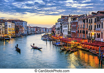 gondolas at sunset in Venice - View of Grand Canal with...