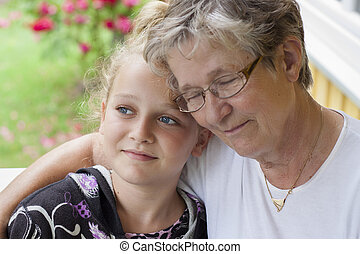 Grandmother and grandchild - And old woman with eyes closed...
