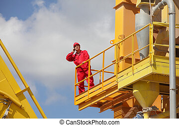 industrial worker on phone