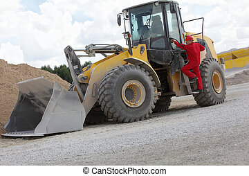 Driver on large  bulldozer