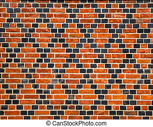 Decorative ornament made by red and black bricks on wall of...