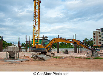 Excavator construction equipment park at worksite and Cement...