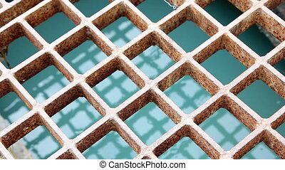 water flow in manhole - closeup to water flow in manhole in...