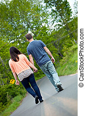 Man and Woman Walking in Street - Young happy couple...