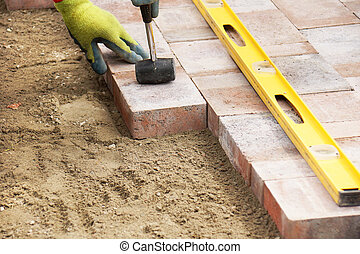 Setting paver - Installing paver bricks on patio, mallet to...