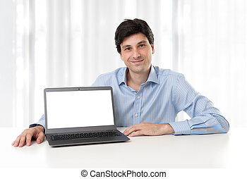 businessman displaying laptop with blank screen - handsome...