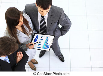 Image of business group discussing business documents at meeting