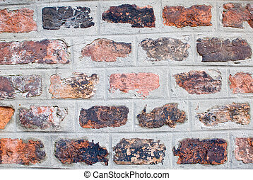 arty bricks - a old and aged brickwall which consists of...