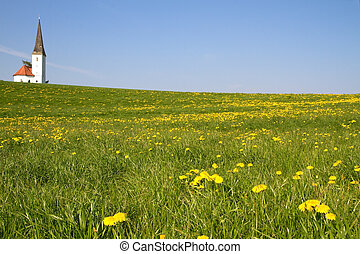Spring meadow with small church in Bavaria