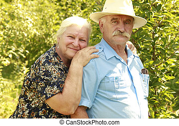 elderly couple in love outdoors