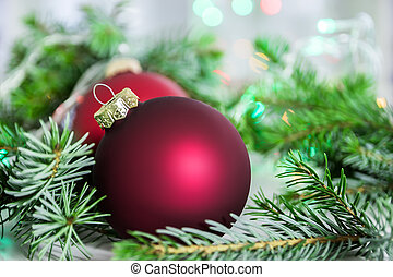 Closeup of christmas balls and christmas tree - Closeup of...