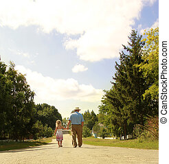 Grandfather and granddaughter are on the road - a...