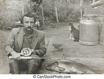 old vintage photo man with a fishing rod - a old vintage...