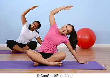 Fitness Class - Teen girl working out in the gym