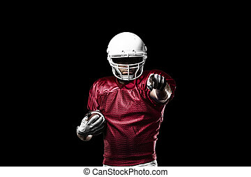 Football Player with a Red uniform celebrating on a Black...