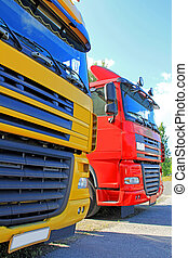 Truck Transport - Two flat-nose trucks close up, transport...
